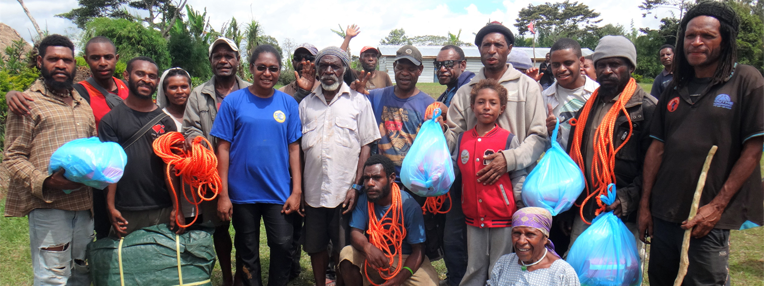 6 – Some of the community with their hygiene kits and tarpaulin and ropes